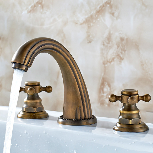 Dos manivelas asociadas a la temperatura del agua